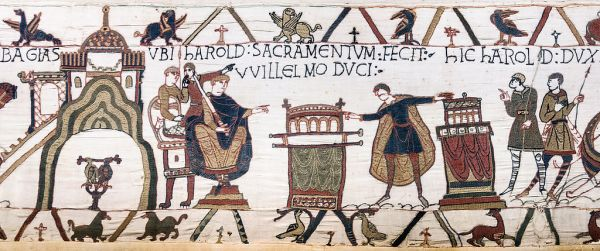 Harold II swearing an oath to William of Normandy, part of the Bayeux Tapestry; via Wikimedia (credit Myrabella)