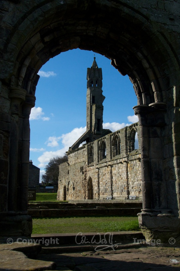 The west end and cloister, viewed through an arch