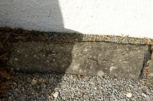 Cross-engraved stone