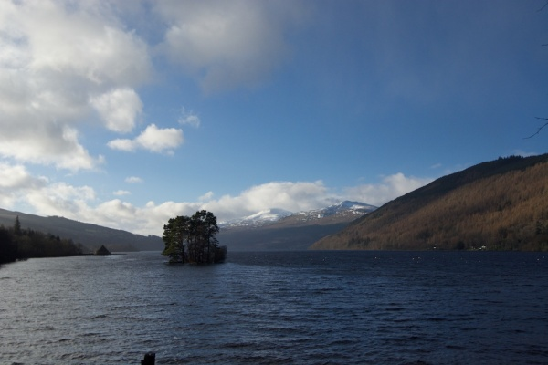 Loch Tay and small crannog, with the Crannog Centre on the far left