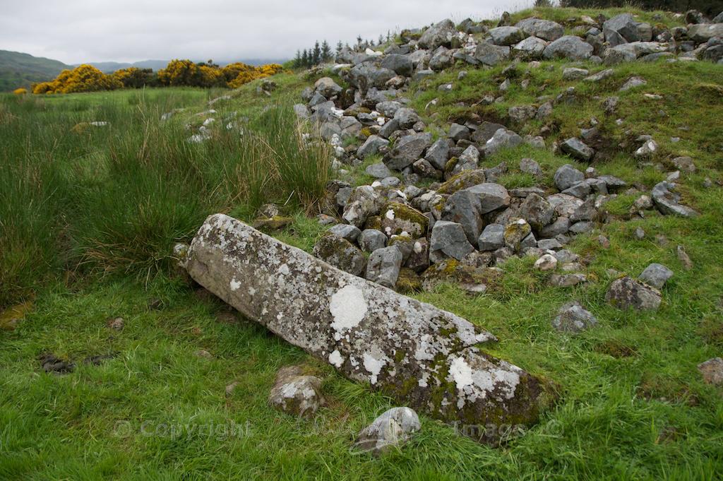 Recumbent stone or fallen monolith marking the false portal