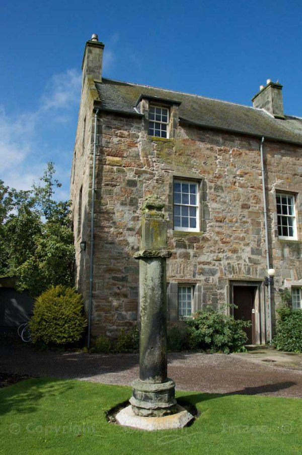 The sundial is dated 1664 and is inscribed 'DWC' for Dr Walter Comrie, a former Principal of the College.