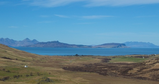 The islands of Rum (left), Eigg (centre) and the Cuillin mountains of Skye (right)